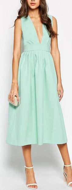okay, I'm so in love with this v neck mint midi dress.  I'd add a lacy cami underneath but the length, cut and color are fabulous!