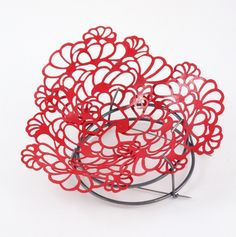 Camilla Luihn. Brooch: Red Spring, 2013. Lacquered copper, oxidized silver.