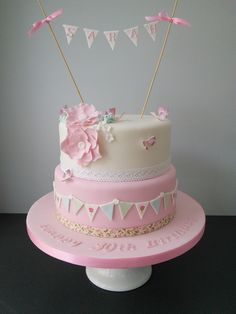 Vintage bunting cake with lace, butterflies and flowers. 40th birthday