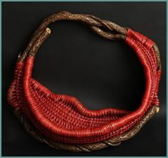 Torch Red, a large pocket wallhanging basket by master weaver Tina Puckett