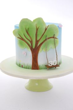 Love the swing! Cake by The Cupcake Lady  THis looks like a High Meadows Cake to me!