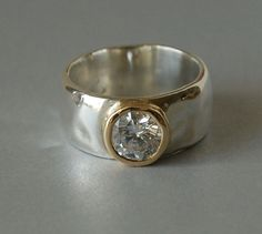 Ring with CZ set in 14k gold bezel