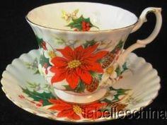 Royal Albert Teacup Saucer Yuletide Poinsettia & Holly Christmas Tea Cup by natalie-w