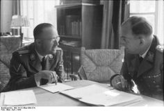 Himmler and General of Police Kurt Daluege confer in 1943.
