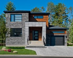 modern wood Cabin with grey accents exterior | Modern Black Garage Doors Also Wooden Bedboard Wall Accent Also Gray ...