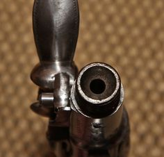 Build around 1779, this typical Queen Anne pistol was loaded by pouring powder into the breech and seating a ball on top in the cone seen here. Then the barrel was screwed back on.
