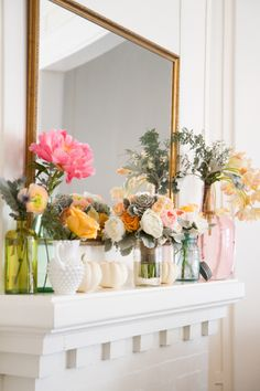 While I think this is especially pretty...it might be difficult to maintain fresh flowers for any sustained period as a mantle display. However, I think the grouping charming and the colors refreshing.