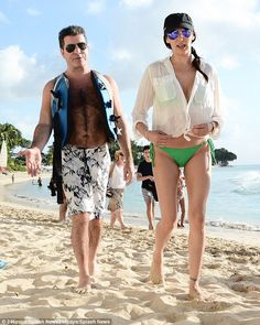 Popular: Simon Cowell and Lauren Silverman have been joined by plenty of their celebrity friends in Barbados this year, ahead of the X Factor boss' rumoured New Year's Eve party