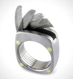 TITANIUM UTILITY RING | This Titanium Utility Ring, known as 'The Man Ring', is a ring every man should own. The ring is crafted from aerospace grade titanium and includes five hidden tools – A working bottle opener, a straight blade, a serrated blade, a saw and a comb. The width of the ring is 9mm and is sized according to the buyer's finger. (via Most Wanted Today)