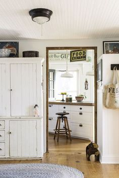 The kitchen of this circa-1875 Victorian home in North Carolina features new cabinetry.