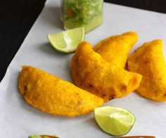 These Colombian Empanadas are a popular snack in Colombia and are served by most Colombian restaurants in the USA. Traditionally, these delicious fritters are Comida Latina, Colombian Cuisine, Colombian Recipes, Colombian Empanada Recipe, Colombian Arepas, Mexican Food Recipes, Ethnic Recipes, Latin Food, Food And Drink