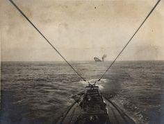 A German U-boat sinks an Allied merchant vessel in the Atlantic Ocean, 1915.