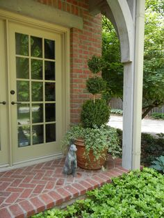 Curb appeal ~ The French Tangerine: ~ topiary, boxwood and ivy