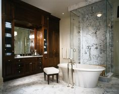 Wood and marble #bathroom with a @BainUltra Sanos #tub. Bathroom designed by Harrison Design Associates (Atlanta, GA). To know more about this #bathtub: http://www.bainultra.com/therapeutic-baths/our-collections/balneo/sanos-7240