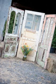 Rustic backyard wedding reception. Easy DIY finding old doors with pretty colours such as these and it really adds that something else to the theme.