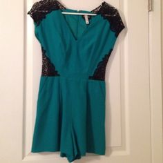 Emerald green and black romper Express romper. Worn twice. Great condition. Pears great woth a blazer and tights. Express Tops