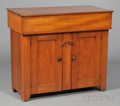 Shaker Red-stained Cherry Dry Sink, Tyringham, Massachusetts, c. 1820-40, the hinged top on a dovetail-constructed box and cockbeaded case of cupboard doors, refinished, ht. 33 1/2, wd. 37 1/2, dp. 19 3/4 in.