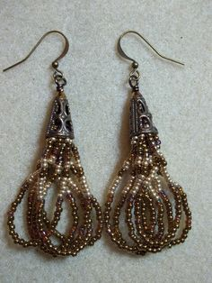 Used this video to make E's earrings in 11/0 seed beads black rainbow (HL) putting a 6/0 seed bead in black rainblow (HL) at the end of each tassel strand--made a tassel instead of a loop type.