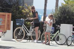Jennifer Garner takes her kids Violet, Seraphina and Samuel shopping and later for a bike ride on August 15, 2014