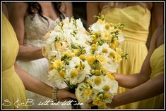 bridesmaids with white dahlias, white garden roses, craspedia, and yellow freesia