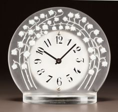 R. LALIQUE FROSTED GLASS, WHITE AND BLACK ENAMEL MARLY CLOCK Circa 1931. Stenciled R. LALIQUE