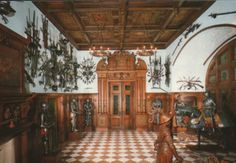 high wainscoting, white walls. peles-castle-hall-of-arms