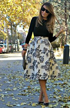 With dinky heels and a tight short sleeved cardi for a cutesy feel. Or layer up with boots for a more stylish feel