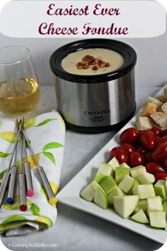 Easy Cheese Fondue - perfect for your next soiree.  So easy to whip up and a hit with guests.  This is a must make recipe to keep in your entertaining repertoire!