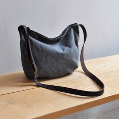 our popular DAY BAG design made from waxed canvas in a lovely charcoal colour with blue undertones outer fabric is a heavy weight 100% waxed canvas with organi