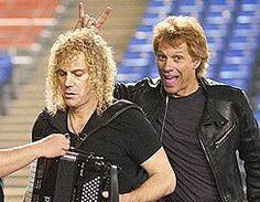 Jon Bon Jovi having some fun with David Bryan playing the accordian