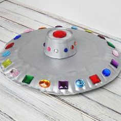 Kids will love making this flying saucer from paper plates and craft jewels!