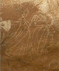 A petroglyph of a bird effigy with human arms found on a rock wall deep in the dark zone of a Tennessee cave.