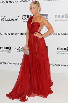 Ashley Tisdale arrives in red at the 20th Annual Elton John AIDS Foundation's Oscar Viewing Party on February 26, 2012 in West Hollywood, California.