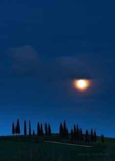 Moonrise over at Val D'orcia, province of Siena,  Tuscany, Italy,  As the moon rises and the day ends, what a beautiful view to make it seem like a dream....
