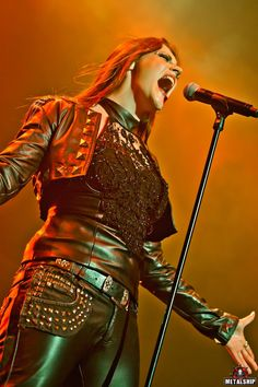 Floor Jansen. Singer of Nightwish. She's so strong and badass on stage!.