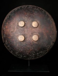 """www.africaandbeyond.com.  Ceremonial Bowl from the Manusian People of Papua New Guinea.  Carved from a single piece of wood, bowls like this were used to eat from and were often made to be given away by the bride's family as their part of the wedding payments during ceremonies. This bowl measures 20.75"""" in diameter and 6"""" deep. When displayed on the included, custom made stand, it reaches a height of 24."""""""