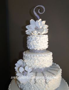 Full view of large and small sugar flowers on a wedding cake. Best Picture For DIY Anniversary decorations For Your Taste You are looking for something, and it is going to tell you exact Wedding Cake Icing, Bling Wedding Cakes, Wedding Cake Prices, Floral Wedding Cakes, White Wedding Cakes, Cool Wedding Cakes, Beautiful Wedding Cakes, Gorgeous Cakes, Wedding Cake Designs