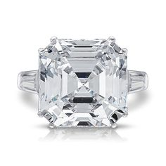 Our Jazz design steps up your Asscher baguette solitaire to the next level! The double prong setting is a fantastic accent for the scale of these larger Asscher stones. Jazz has one tapered baguette on each side. Main pictures show the 11.0 carat center.  Available in 14K white gold or 14K yellow gold.