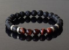 Free Shipping - Onyx stone 8 mm ,Black Lava Stone 8 mm, Red Tiger Eye Stone 8 mm, crafted on a Strong Stretch Cord Bracelet. When you need a boost of creative energy, reinforces the ability and motivation to do. Mens Beaded Bracelets, Mens Bracelet, Mens Energy Bracelet, Black Onyx