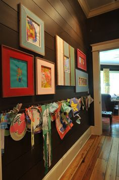 Kids art wall. Love that it is mixing the easy hang up with the frames. Display your favorite but the kids still feel like every piece is a masterpiece
