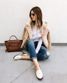 A shearling jacket with jeans and a tee.
