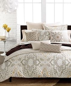 Love this bedding! Will look great on a bed made of dark wood. Macys.