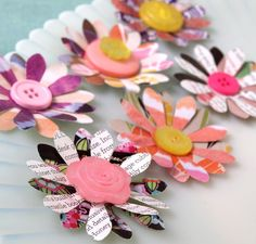Flowers using recycled catalog pages & buttons.