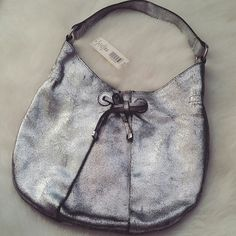 $25! NWT- Kate Landry Metallic Hobo Shoulder Bag ** FINAL PRICE ** 15% OFF BUNDLES!  Condition: Brand new with tags.  Gorgeous silver metallic hobo bag that will go with just about any outfit!! Has 2 pockets inside: 1 small; 1 large with 1 zip compartment.  NO TRADES!! Kate Landry Bags Hobos