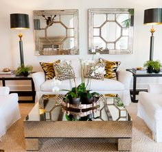 greek key sisal, white slipcovered furniture, animal print, and mirrored coffee table.