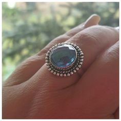 Sweet blue topaz stone ring size 8 Absolutely adorable ring!  Sweet hand made blue topaz stone with silver bead look detail surround.  Sterling silver overlay and marked 925.  New with tags size 8 Jewelry Rings