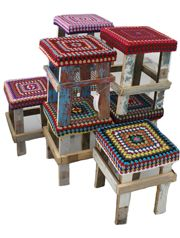 I'll bet we could make some stools like this in a hurry. It would take me longer to crochet the tops but maybe if I did one and then left a basket of yarn around family members would do it when they visit ;-)