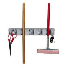 Organize and store your cleaning tools in a elegant way with this Wall Rack Tool Cleaning Organizer from Genuine Joe. Ideal for brooms and mops. Office Supply Organization, Office Organization, Organizing Ideas, Tool Storage, Storage Spaces, Garage Storage, Garage Shelving Plans, Resin Sheds, Small Parts Organizer