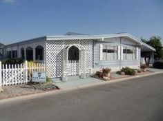 Lattice and arbor on this home are super cute! via MHVillage #mobilehome #porch