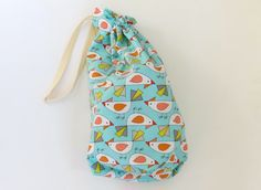 This handy turquoise blue, green and orange drawstring bag is ideal as an easter basket or childrens party bag. The Easter chicken pattern pouch has a